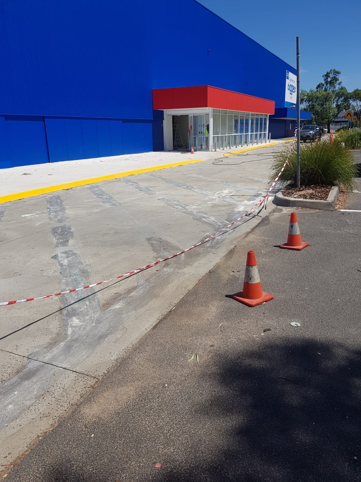 Paint stripping road lines Officeworks Mentone
